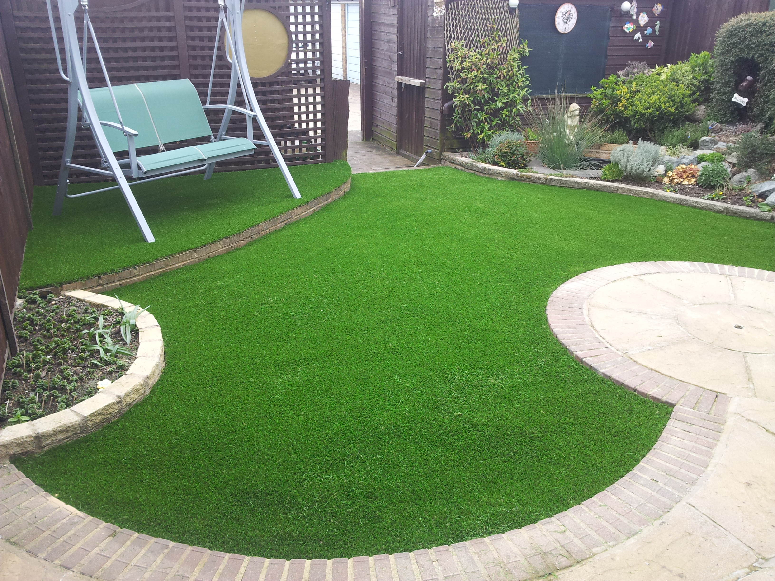 Image result for artificial grass on concrete